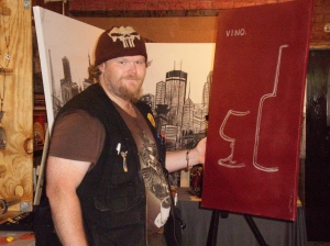 Michael Treat creating a wine painting at the LoLa Art Crawl