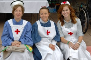 With period nurses in white uniforms